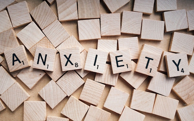 "Scrablle Tiles that spell out ""ANXIETY"""